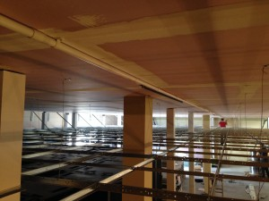 The main lighting conduit installed above the ceiling void