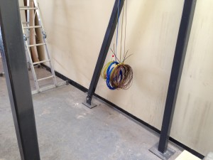 Coiled lighting power cables ready for routing back to power distribution room