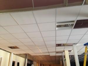 Tile installation begins in ground floor ceiling grid