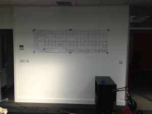 Template in place for mounting our logo in the office