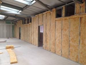Insulation fitted into cold corridor enclosure