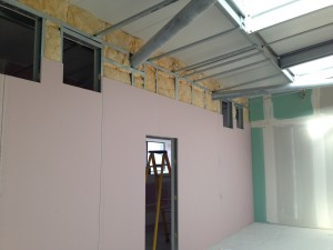 Enclosure insulation reaching ceiling