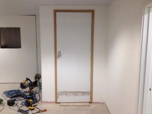 Custom extended lift shaft door installed on first floor