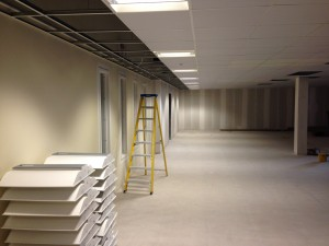 Emergency lighting row installed into ceiling, along the main access run leading to cold corridor pods