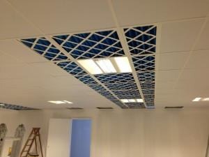 Air filters installed in ceiling grid, for first cold corridor containment pod