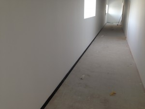 Installation of our custom tanked floor begins in the cold corridor