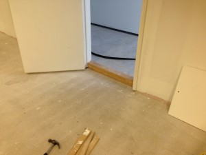 Up-stands are installed in cold corridor access doors to allow for floor tanking