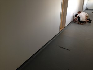 Flooring is cut to size and fitted to the edging
