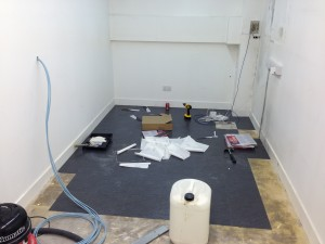 Flooring being laid in the first floor build room / server prep area