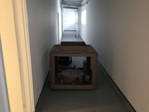 Stripped wet box cooling unit placed into corridor for framework testing