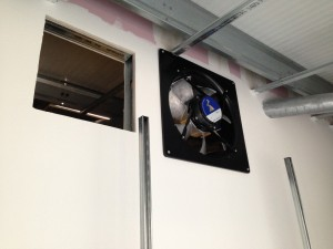 First inlet fan installing into cold corridor enclosure ahead of duct work installation