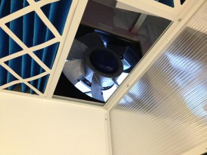 A view of the fan from the data hall side of the enclosure, where pre-filtered cold air will fill the air plenum and drop through the ceiling filters into the technical space
