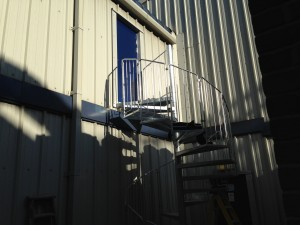 Landing platform and hand rail assembly installed