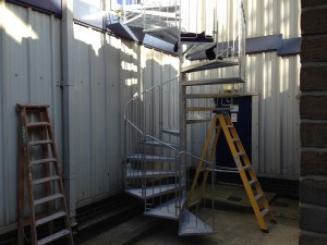 A look at the staircase as final fixings are made