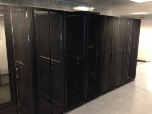 A look at the rear of the first row, with a custom solution for creating a seamless rear door surface despite the UPS being a different depth to the server cabinets