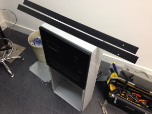 Power distribution enclosure being fitted with modified and sprayed door panels