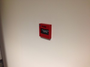 New fire alarm call points being installed throughout the facility