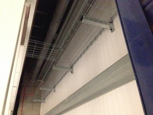 Internal generator containment spine along external cladding, ahead of cable exits being cut into the external facial