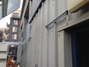 Cable basket affixed to generators and cladding