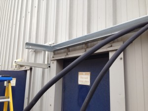 External pipework and cable containment installed, along with bracket for external condenser
